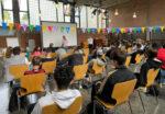 Schüler:innen in der Aula der KHS Bülowstrasse